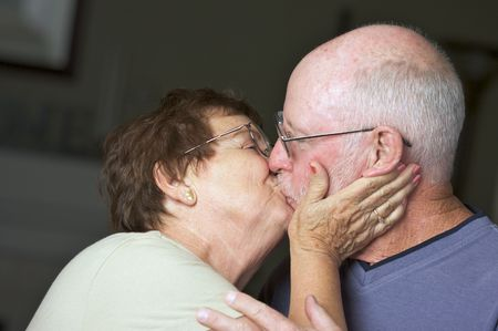 Happy Senior Adult Couple Kissing
