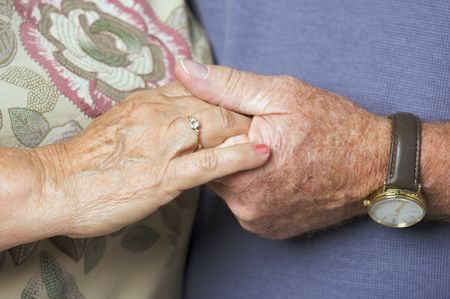 Happy Senior Adult Couple Holding Hands photo