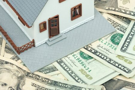 Home and Money on a Money Background photo