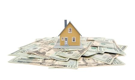 Home and Money Isolated on a White Background photo