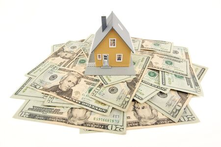 downpayment: Home and Money Isolated on a White Background Stock Photo