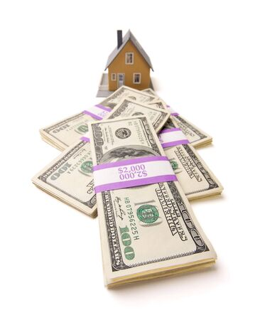 in escrow: Home and Stacks of Money Isolated on a White Background
