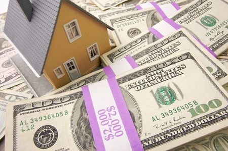 downpayment: Home with Stacks of Money as Background.