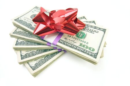 holiday spending: Stack of Money with Bow Isolated on a White Background.