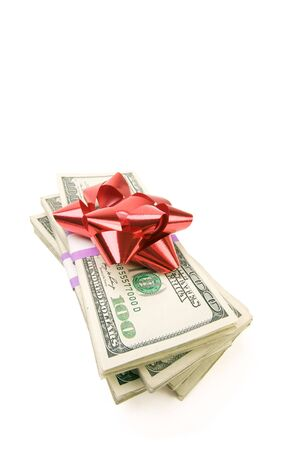 christmas debt: Stack of Money with Bow Isolated on a White Background.