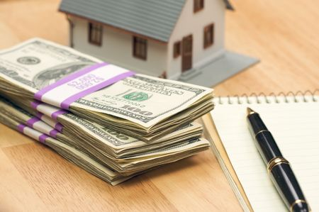 loans: House and Money with Pad of Paper and Pen Stock Photo