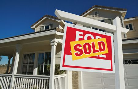 Sold Home For Sale Sign in Front of New House Stock Photo - 3900431