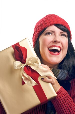 Attractive Woman Holds Holiday Gift Isolated on a White Background. photo