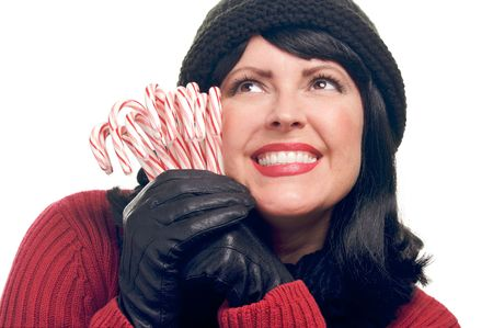 Attractive Woman Holds Candy Canes Isolated on a White Background. photo