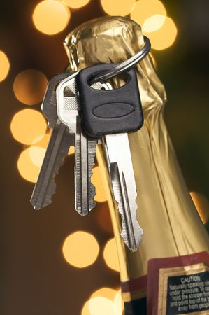 dont drink and drive: Dont Drink and Drive - Keys and Champagne in Holiday Abstract Background. Stock Photo