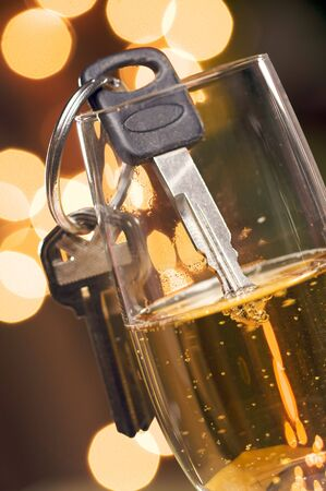 under the influence: Dont Drink and Drive - Keys and Champagne in Holiday Abstract Background. Stock Photo