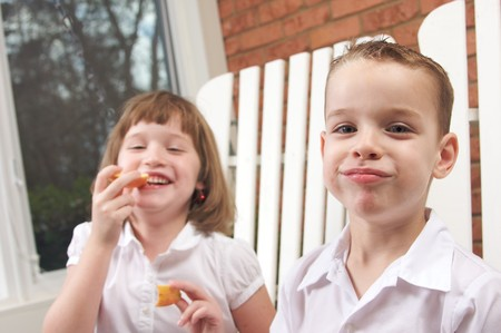 preteen  pure: Sister and Brother Having Fun Eating an Apple