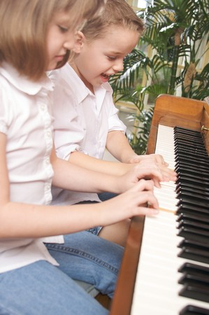 Brother and Sister Playing the Piano Together Stock Photo - 4100264
