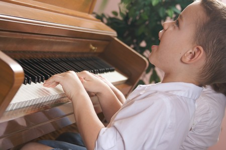 Brother and Sister Playing the Piano Together photo