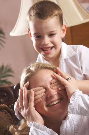 living moment: Young Mother and Son Enjoying a Tender Moment Stock Photo