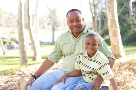Man and Child Having fun in the park. Stock Photo - 4127361