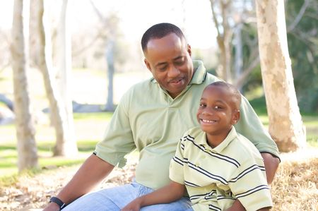 Man and Child Having fun in the park. Stock Photo - 4127354