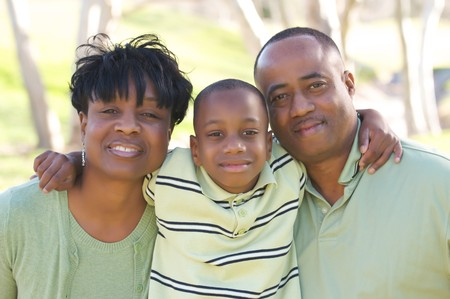 Man, Woman and Child having fun in the park. Stock Photo - 4135820