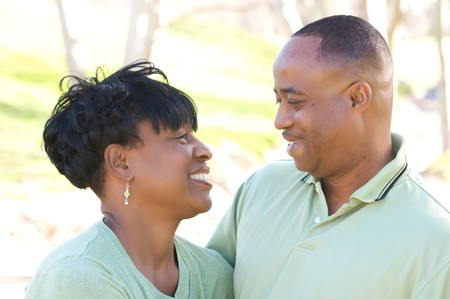 Happy Affectionate Couple posing in the park. Stock Photo - 4135796