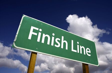 clinch: Finish Line Road Sign with Dramatic Clouds and Sky.