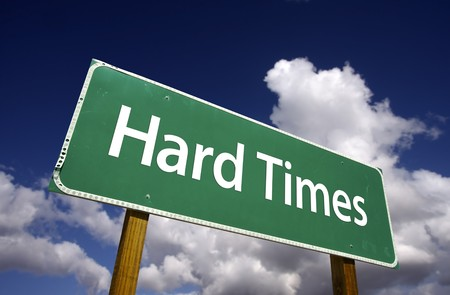 hard times: Hard Times Road Sign with Dramatic Clouds and Sky. Stock Photo