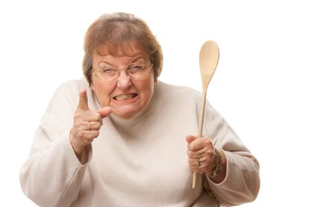 grandma: Upset Senior Woman with The Wooden Spoon Isolated on a White Background.