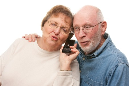Happy Senior Couple Using Cell Phone Isolated on a White Background. photo