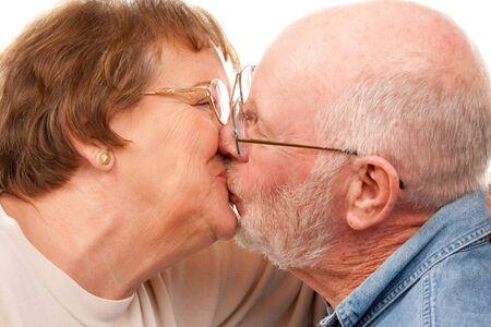 Affectionate Senior Couple Kissing Isolated on a White Background. Stock Photo - 4176275