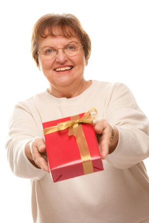 Attractive Senior Woman with Gift  in Hands Isolated on a White Background. photo