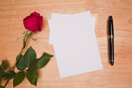 Blank Card, Rose and Pen on a Wood Background. Stock Photo - 4221443
