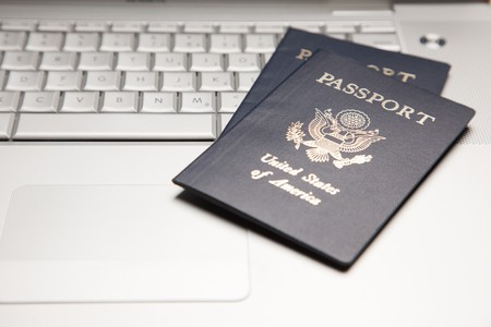 Abstract of Two Passports on a Laptop Computer Keyboard. Stock Photo - 4281967