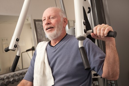 senior adult man: Senior Adult Man Working Out in the Gym.