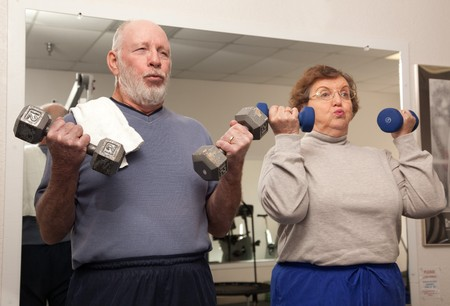 Senior Adult Couple Working Out in the Gym. photo