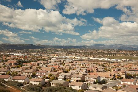 expanse: Elevated View of New Contemporary Suburban Neighborhood and Majestic Clouds.