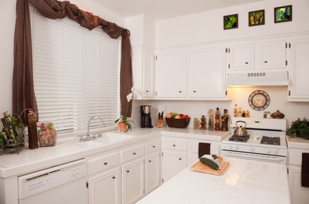 White Modern Kitchen Interior. The images on the wall are my copyrighted photos as well. Stock Photo - 4399278