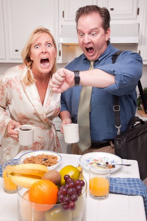 Late for Work Stressed Couple Checking Time in Kitchen. Stock Photo - 4391951
