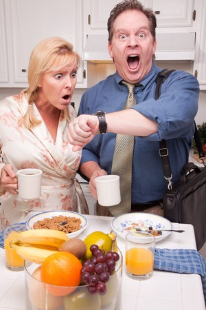 Late for Work Stressed Couple Checking Time in Kitchen. Stock Photo - 4391953