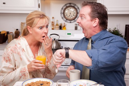 Late for Work Stressed Couple Checking Time in Kitchen. Stock Photo - 4391969