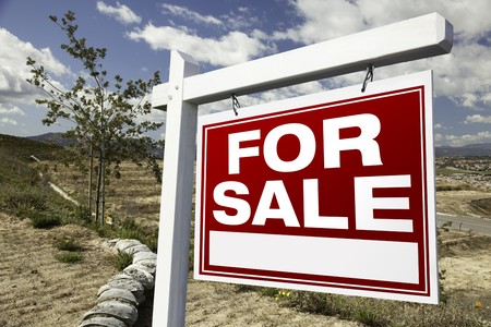 purchase: For Sale Real Estate Sign and Emtpy Construction Lots - Ready for your own message.