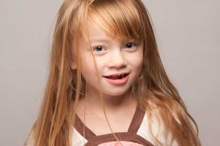 grey haired: Portrait of an Adorable Red Haired Girl on a Grey Background.