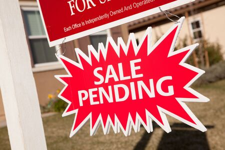 pending: Red Sale Pending Real Estate Burst Sign. Stock Photo