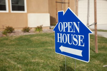sell house: Blue Open House Real Estate Sign in Front Yard of Home. Stock Photo