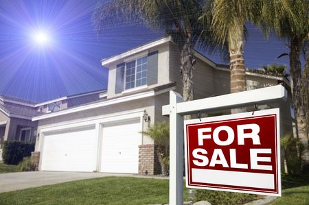 sales agent: Red For Sale Real Estate Sign in Front of House with Blue Star-burst in Sky. Stock Photo