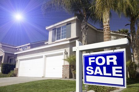 property for sale: Blue For Sale Real Estate Sign in Front of House with Blue Star-burst in Sky.