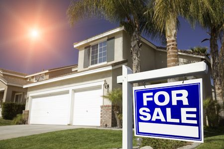 Red For Sale Real Estate Sign in Front of House with Red Star-burst in Sky. Stock Photo - 4637949