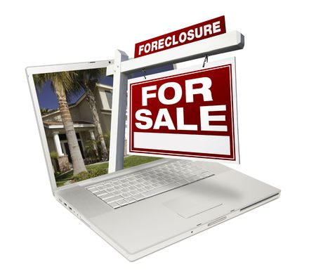 Foreclosure Home for Sale Real Estate Sign & Laptop Isolated on a White Background. photo