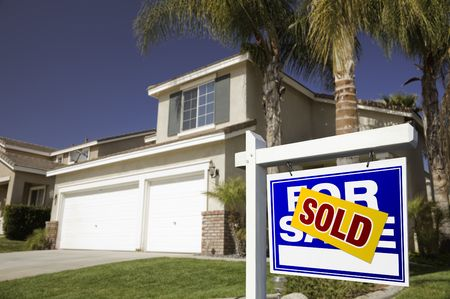 Blue Sold For Sale Real Estate Sign in Front of House. Stock Photo - 4652314