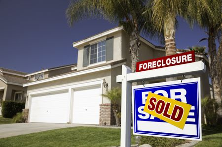 Blue Foreclosure For Sale Real Estate Sign in Front of House. photo