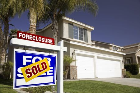 dispossession: Blue Foreclosure For Sale Real Estate Sign in Front of House.