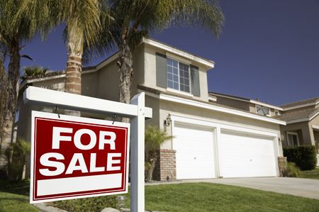 sales agent: Red For Sale Real Estate Sign in Front of House. Stock Photo